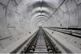 Rail and sleepers aligned in Thames tunnel prior to concrete track slab pour. CROSSRAIL LTD.