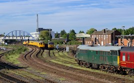 DCRail 31452 and 56303 are stabled as Colas Rail 37099 propels a Crewe-Derby test train into Derby on May 20. PAUL ROBERTSON.