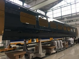 A completed Caledonian Sleeper Mk 5 bodyshell in CAF's Beasain factory, northern Spain. CALEDONIAN SLEEPER.